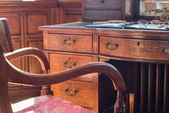 Fine antique pedestal writing desk. Studying history and period stock photo