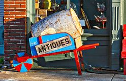 Fine Antiques Shop Wheel Barrow Stock Photo