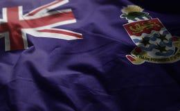 Fine arruffata bandiera delle Isole Cayman su fotografia stock