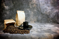 Fine art coffee cup whole beans and bags royalty free stock photos