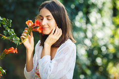 Fine art girl with a flower in the hands royalty free stock photos