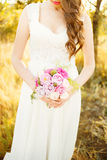 Fine art girl with a flower in the hands Royalty Free Stock Photography