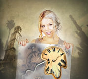 Fine Art of Going Old Concept.Time flies. Young attractive woman going old holding placard with clock and steal pipe melting down. Before and after.Time passing Royalty Free Stock Photography