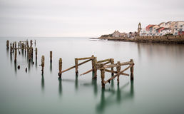Fine art landscape image of derelict pier in milky long exposure Stock Photos