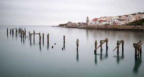 Fine art landscape image of derelict pier in milky long exposure Royalty Free Stock Images