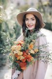 Fine art lifestyle Fashion model flowers in park stock image