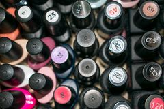 Fine art nail concept with a lot of bottles nail polish viewed f royalty free stock images
