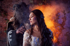 Fine art photo of beauty and beast. Beautiful girl and a monster, fairy tale, concept. Fine art photo of beauty and beast Stock Images