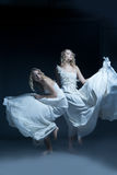 Dancing girl in wedding dress with multiexposition Royalty Free Stock Images