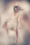 Fine art photo of woman in white dress Stock Image