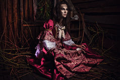 Fine art photo of a young fashion lady in a dark mystic location. Royalty Free Stock Image