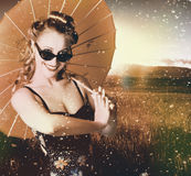 Vintage American pin-up girl in summer rain Royalty Free Stock Photography