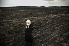 Fine art portrait of girl on black field Royalty Free Stock Photography