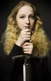 Fine art portrait of girl with sword stock image