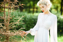 Fine art portrait of a girl in white vintage dress Royalty Free Stock Photo