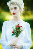 Fine art portrait of a girl in white vintage dress Stock Photo