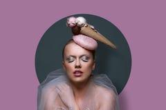 Fine art portrait of a gorgeous woman a fascinator Stock Images
