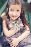 Fine art portrait of little girl with  a cat Stock Photo