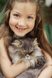 Fine art portrait of little girl and her cat Stock Images