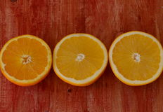 Fine art still life with oranges on wooden table Stock Photo