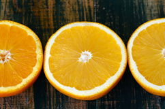 Fine art still life with oranges on wooden table Royalty Free Stock Image