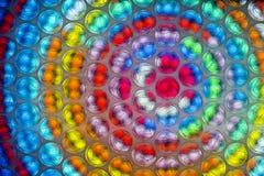 Fine astratta sullo strato dell'involucro di bolla con fondo variopinto immagini stock libere da diritti