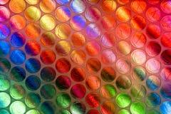 Fine astratta sullo strato dell'involucro di bolla con fondo variopinto fotografie stock