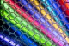 Fine astratta sullo strato dell'involucro di bolla con fondo variopinto immagini stock