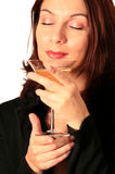 Fine beverage woman. Good looking woman enjoying a cup of fine wine Royalty Free Stock Photo