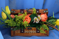 Fine Bouquet from roses, tulips and lilies. In a casket Royalty Free Stock Photos