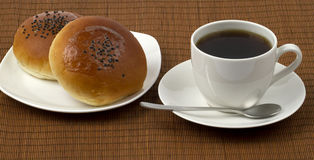 Fine breakfast. Of a fresh roll and boiled black coffee Stock Photos