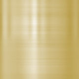 Fine brushed gold metal. Very finely brushed gold metal background texture Stock Images