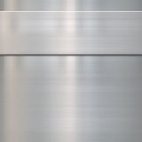 Fine brushed steel metal. Very finely brushed steel metal background texture with panel Royalty Free Stock Images