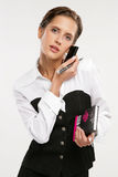 Fine business-lady. Attractive Fine business-lady holds phone and a book Royalty Free Stock Photo