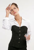 Fine business-lady. Attractive young business-lady holds tablets and a glass of water Stock Images