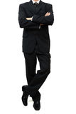 Fine businessman standing with legs and arms crossed Stock Image