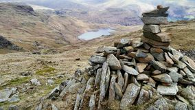 Fine cairn overlooking Easedale Tarn, Lake District, Widescreen Stock Images