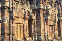 Fine carvings. Background details of the highly intricate carved banteay srey temple Royalty Free Stock Photos