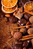 Fine chocolates, nuts and spices Stock Photos