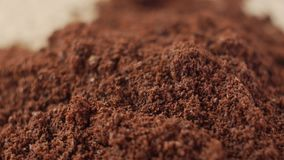 Fine coffee powder pile close-up shallow DOF. stock video footage