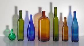 Fine color glass bottles. Composition from color glass bottles Stock Photos