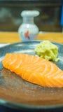Fine cruda di color salmone del sashimi su Fotografia Stock