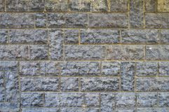 Fine cut blue stone wall. The background for the blue stone wall texture stock photos
