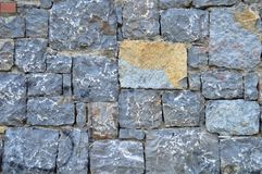 Fine cut blue stone wall. The background for the blue stone wall texture stock photo