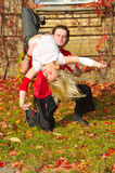 Fine dancing couple on autumn background Royalty Free Stock Photos