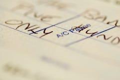 Fine del libro contabile dell'assegno in su Fotografia Stock Libera da Diritti