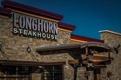 Fine del segno dello steakhouse della mucca texana su Fotografia Stock Libera da Diritti