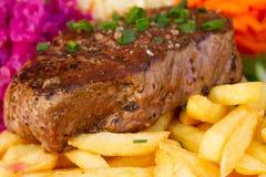 Fine della bistecca della carne su Immagine Stock