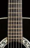 Fine della chitarra acustica in su Immagine Stock