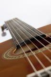 Fine della chitarra acustica in su Fotografia Stock
